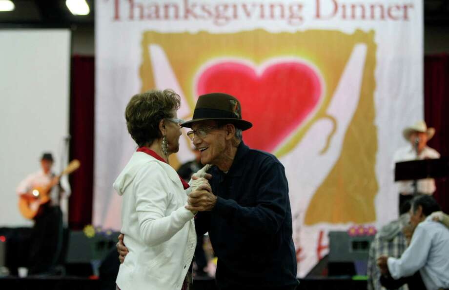 Maria Montalvo and Richrad Benavidez dance during the 32nd annual Raul Jimenez Thanksgiving Dinner, Nov. 24, 2011 at the Convention Center.  Photo: HELEN L. MONTOYA, San Antonio Express-News / SAN ANTONIO EXPRESS-NEWS