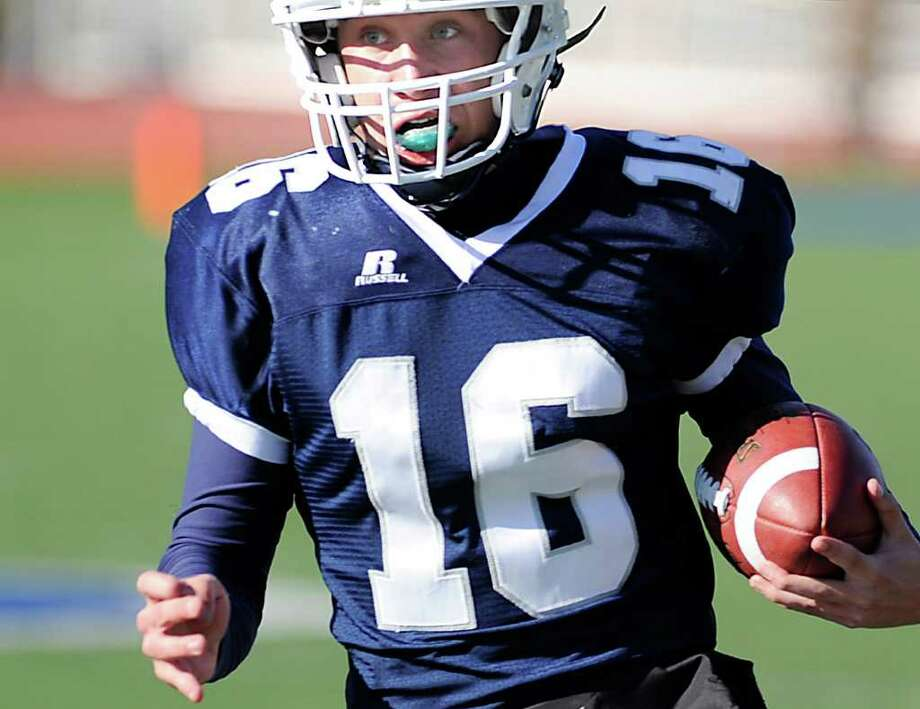 QB Jack Massie of Staples High School runs the ball during the FCIAC Football Championship game in which Staples High School defeated Greenwich High School 31-27 at Staples, Westport, Thursday afternoon, Nov. 24, 2011. Photo: Bob Luckey / Greenwich Time