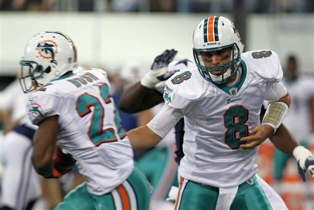 Miami Dolphins quarterback Matt Moore (8) hands off to running back Reggie Bush (22) in the first half of an NFL football game against the Dallas Cowboys Thursday, Nov. 24, 2011, in Arlington, Texas. (AP Photo/Sharon Ellman) Photo: Associated Press