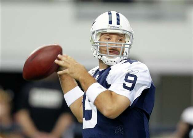Dallas Cowboys quarterback Tony Romo (9) prepares to throw against the Miami Dolphins in the first half of an NFL football game, Thursday, Nov. 24, 2011, in Arlington, Texas. (AP Photo/Sharon Ellman) Photo: Associated Press