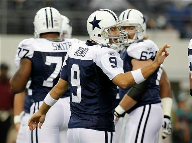 Dallas Cowboys quarterback Tony Romo (9) at the line of scrimmage in the first half of an NFL football game against the Miami Dolphins Thursday, Nov. 24, 2011, in Arlington, Texas. (AP Photo/Sharon Ellman) Photo: Associated Press