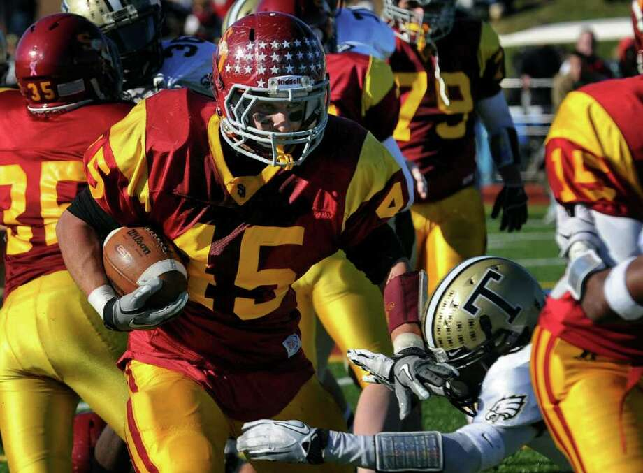 St. Joseph's #45 Mike Pulaski carries the ball, during Thanksgiving Day boys football action against Trumbull in Trumbull, Conn. on Thursday November 24, 2011. Photo: Christian Abraham / Connecticut Post