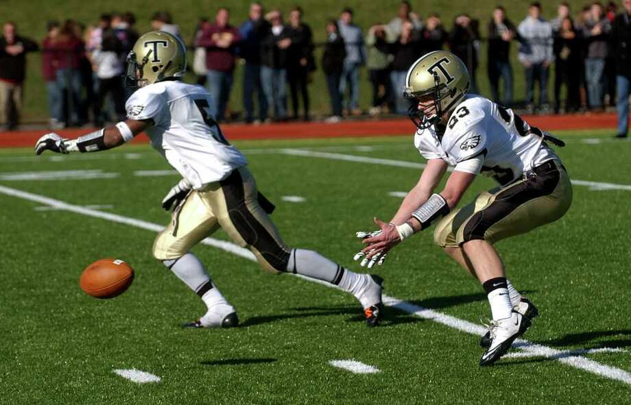 Highlights from Thanksgiving Day boys football action between St. Joseph and Trumbull in Trumbull, Conn. on Thursday November 24, 2011. Trumbull's #23 Michael Uus receives the snap. Photo: Christian Abraham / Connecticut Post
