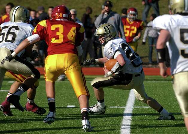 Highlights from Thanksgiving Day boys football action between St. Joseph and Trumbull in Trumbull, Conn. on Thursday November 24, 2011. Trumbull's #23 Michael Uus carries the ball. Photo: Christian Abraham / Connecticut Post