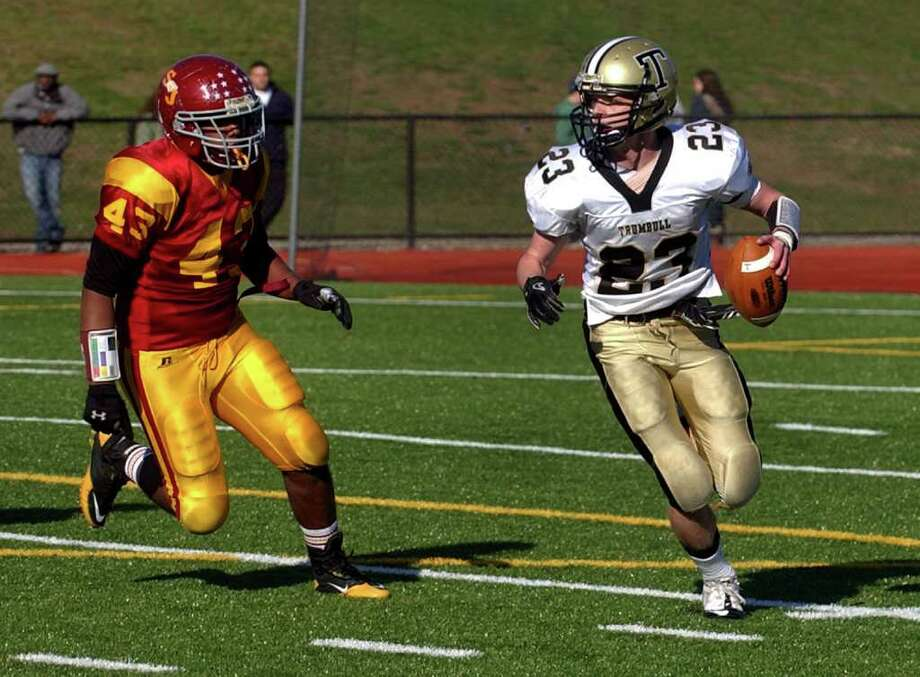 Highlights from Thanksgiving Day boys football action between St. Joseph and Trumbull in Trumbull, Conn. on Thursday November 24, 2011. St. Joseph's #43 Alexis Guadalupe chases down Trumbull's #23 Michael Uus. Photo: Christian Abraham / Connecticut Post