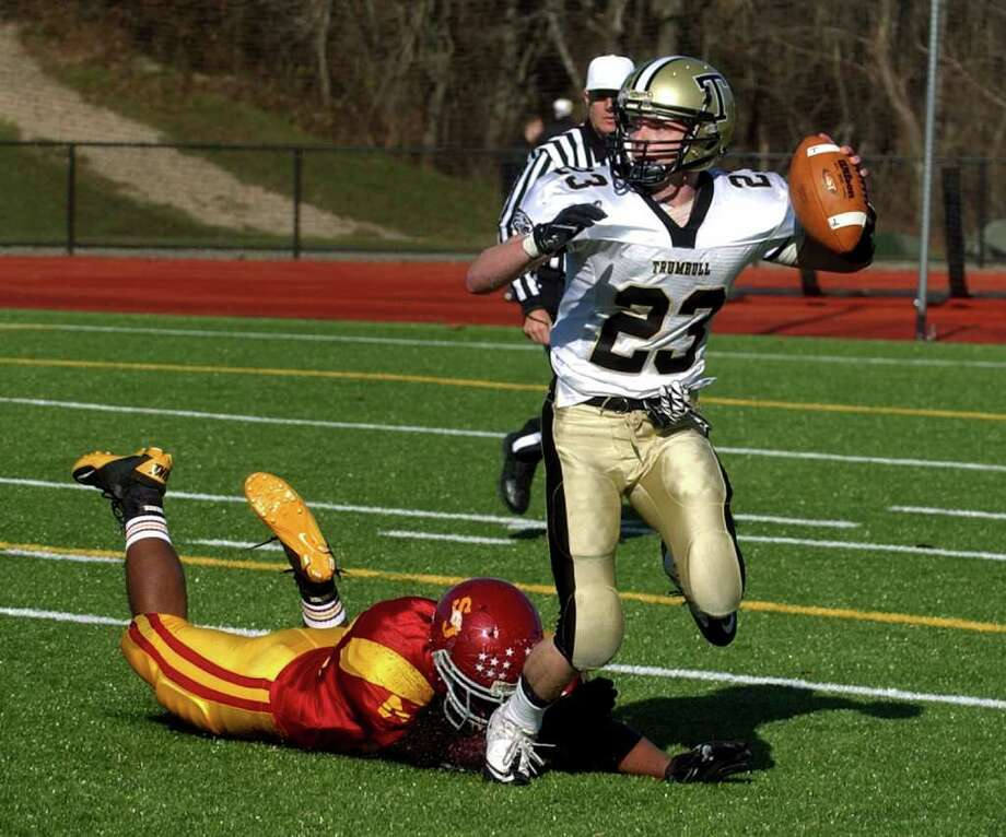 Highlights from Thanksgiving Day boys football action between St. Joseph and Trumbull in Trumbull, Conn. on Thursday November 24, 2011. St. Joseph's #43 Alexis Guadalupe narrowly misses grabbing Trumbull's #23 Michael Uus. Photo: Christian Abraham / Connecticut Post