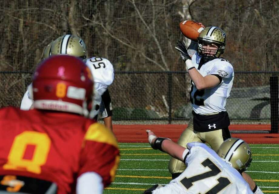 Highlights from Thanksgiving Day boys football action between St. Joseph and Trumbull in Trumbull, Conn. on Thursday November 24, 2011. Trumbull QB #12 Brendan Moore. Photo: Christian Abraham / Connecticut Post