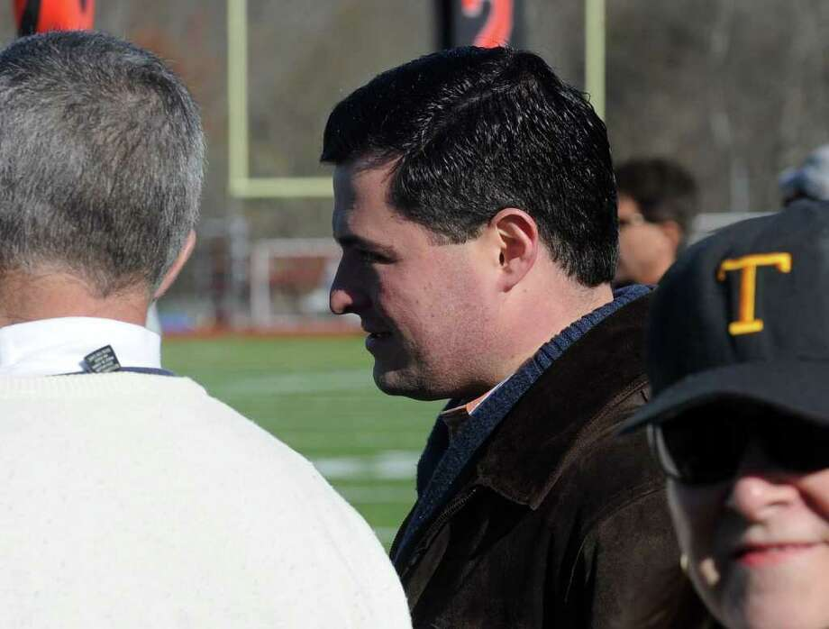 Highlights from Thanksgiving Day boys football action between St. Joseph and Trumbull in Trumbull, Conn. on Thursday November 24, 2011. First Selectman Tim Herbst watches the action from the sidelines. Photo: Christian Abraham / Connecticut Post