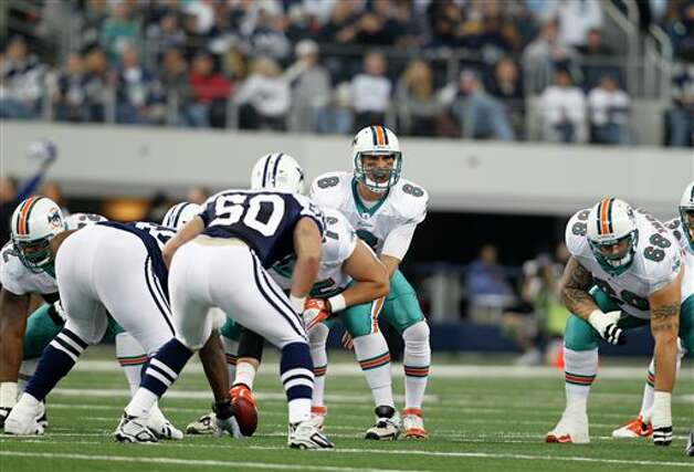 Miami Dolphins quarterback Matt Moore (8) at the line of scrimmage during the first half of an NFL football game against the Dallas Cowboys Thursday, Nov. 24, 2011, in Arlington, Texas. (AP Photo/Sharon Ellman) Photo: Associated Press