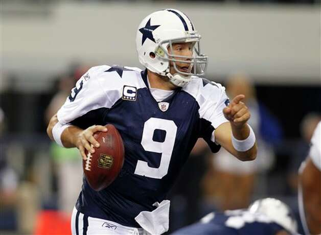 Dallas Cowboys quarterback Tony Romo (9) scrambles out of the pocket against the Miami Dolphins in the first half of an NFL football game Thursday, Nov. 24, 2011, in Arlington, Texas. (AP Photo/Sharon Ellman) Photo: Associated Press