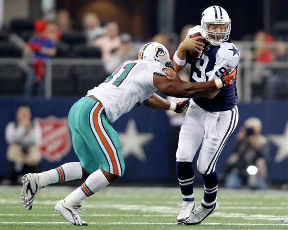 Miami Dolphins outside linebacker Cameron Wake (91) chases down Dallas Cowboys quarterback Tony Romo (9) for a sack in the first quarter of an NFL football game, Thursday, Nov. 24, 2011, in Arlington, Texas. (AP Photo/Sharon Ellman) Photo: Associated Press