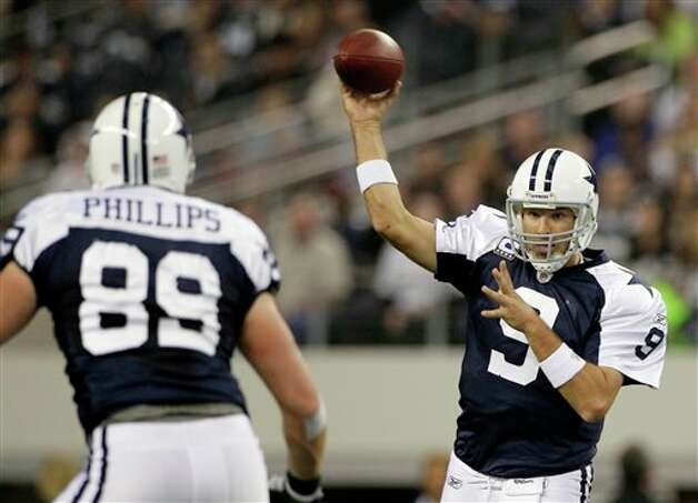 Dallas Cowboys quarterback Tony Romo (9) throws to tight end John Phillips (89) in the first half of an NFL football game against the Miami Dolphins, Thursday, Nov. 24, 2011, in Arlington, Texas. (AP Photo/Matt Strasen) Photo: Associated Press