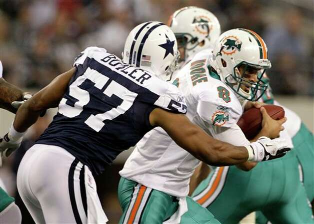 Dallas Cowboys linebacker Victor Butler (57) sacks Miami Dolphins quarterback Matt Moore (8) in the second quarter of an NFL football game, Thursday, Nov. 24, 2011, in Arlington, Texas. (AP Photo/Matt Strasen) Photo: Associated Press