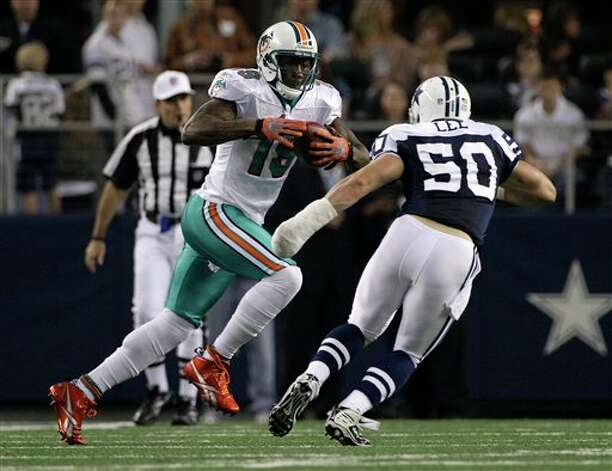 Miami Dolphins wide receiver Brandon Marshall (19) looks for running room against Dallas Cowboys inside linebacker Sean Lee (50) in the first half of an NFL football game Thursday, Nov. 24, 2011, in Arlington, Texas. (AP Photo/Matt Strasen) Photo: Associated Press