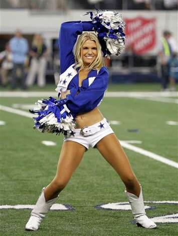 A member of the Dallas Cowboys cheerleaders performs during an NFL football game against the Miami Dolphins Thursday, Nov. 24, 2011, in Arlington, Texas. (AP Photo/Sharon Ellman) Photo: Associated Press
