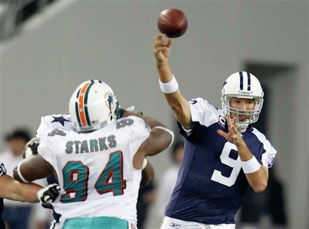 Miami Dolphins defensive end Randy Starks (94) pressures as Dallas Cowboys quarterback Tony Romo (9) passes in the first half of an NFL football game Thursday, Nov. 24, 2011, in Arlington, Texas. (AP Photo/Sharon Ellman) Photo: Associated Press