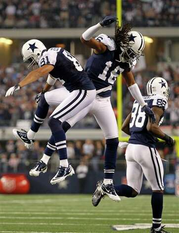 Dallas Cowboys wide receiver Laurent Robinson, left, and wide receiver Jesse Holley (16) celebrate Robinson's touchdown as wide receiver Dez Bryant (88) heads back to the bench in the first half of an NFL football game against the Miami Dolphins, Thursday, Nov. 24, 2011, in Arlington, Texas. (AP Photo/Sharon Ellman) Photo: Associated Press