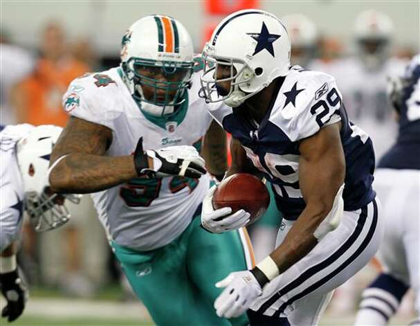 Dallas Cowboys running back DeMarco Murray (29) runs past Miami Dolphins defensive end Randy Starks (94) in the first half of an NFL football game, Thursday, Nov. 24, 2011, in Arlington, Texas. (AP Photo/Sharon Ellman) Photo: Associated Press