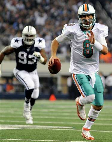 Miami Dolphins quarterback Matt Moore (8) finds running room from the line of scrimmage as Dallas Cowboys outside linebacker Anthony Spencer (93) gives chase in the first half of an NFL football game, Thursday, Nov. 24, 2011, in Arlington, Texas. (AP Photo/Matt Strasen) Photo: Associated Press