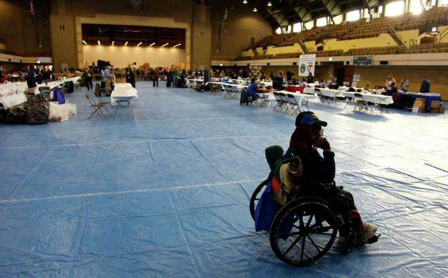 A veteran waits to receive benefits at an event in Chicago. Many military families are finding it hard to put food on the table during the current tough economy. Nonprofit groups are struggling to provide aid. Photo: ROBERT RAY, ASSOCIATED PRESS
