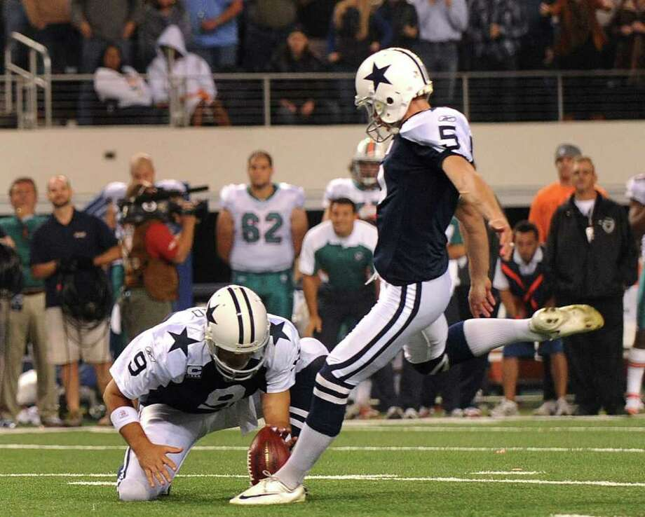 Dallas Cowboys kicker Dan Bailey kicks the game-winning field goal as Tony Romo holds the ball during second-half NFL action against the Miami Dolphins at Cowboys Stadium on Thanksgiving Day, Nov. 24, 2011. BILLY CALZADA / gcalzada@express-news.net  Miami Dolphins at Dallas Cowboys Photo: BILLY CALZADA, Express-News / gcalzada@express-news.net