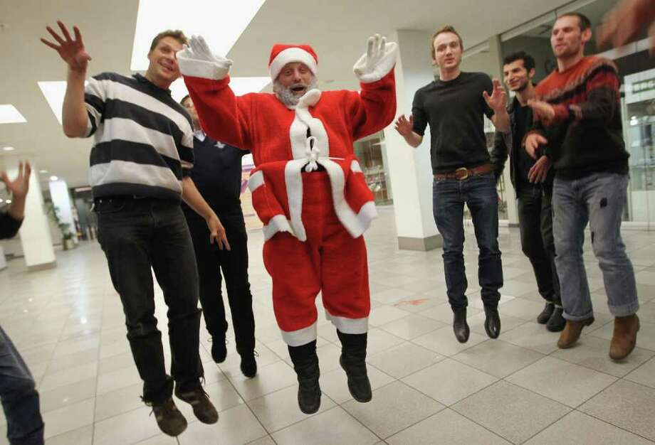 "Stephan ""Stippi"" Antczack, alias Santa Claus, leads Santas-to-be in a theatrical exercise as part of his Santa workshop at the Studentenwerk Berlin in Berlin, Germany. Photo: Sean Gallup, Getty / 2011 Getty Images"
