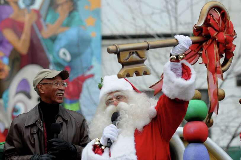 Santa, right,  receives the key to the city from Detroit Mayor David Bing during the 85th annual Ame