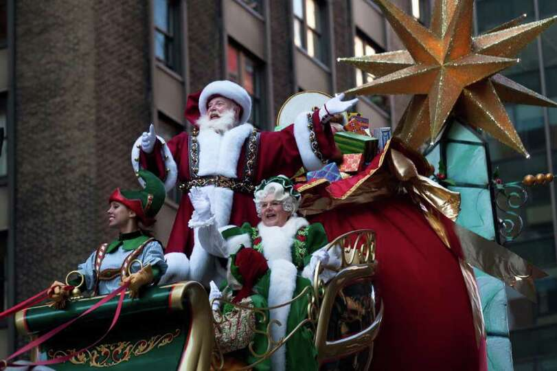 Santa Claus waves at spectators during the Macy's Thanksgiving Day Parade, Thursday, Nov. 24, 2011,