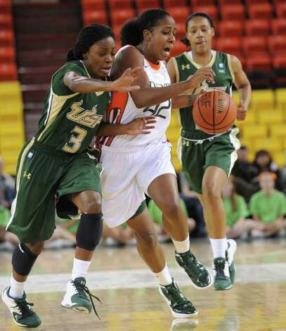 Miami's Shenise Johnson (42) drives upcourt against the defense of South Florida's Kaneisha Saunders during their NCAA college basketball championship game of the Great Alaska Shootout, Thursday, Nov. 24, 2011, in Anchorage, Alaska. Photo: AP