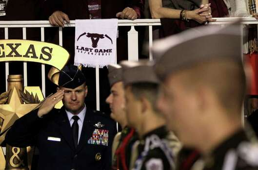 A towel touting the final Texas A&M and Texas game hangs on the reviewing stand as the Corps of Cadets march into the stadium before an NCAA college football game at Kyle Field Thursday, Nov. 24, 2011, in College Station. Photo: Brett Coomer, Houston Chronicle / © 2011 Houston Chronicle