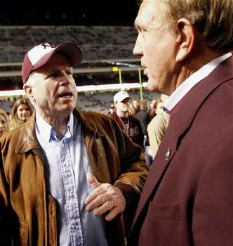 Sen. John McCain, left, talks with former Texas A&M coach Jackie Sherrill, right, before an NCAA college football game between Texas and Texas A&M, Thursday, Nov. 24, 2011, in College Station, Texas. (AP Photo/David J. Phillip) Photo: Associated Press