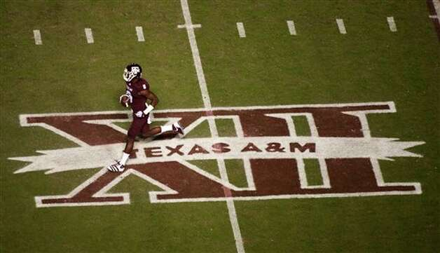 Texas A&M's Jeff Fuller warms up before an NCAA college football game against Texas, Thursday, Nov. 24, 2011, in College Station, Texas. (AP Photo/Dave Einsel) Photo: Associated Press