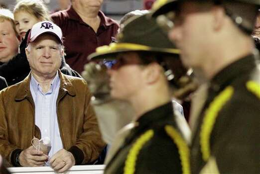 Sen. John McCain, left, watches members of the Parsons Mounted Cavalry before an NCAA college football game between Texas A&M and Texas, Thursday, Nov. 24, 2011, in College Station, Texas. (AP Photo/David J. Phillip) Photo: Associated Press