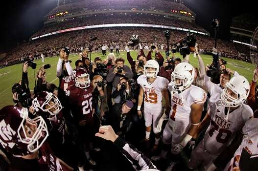 An official tosses the coin in the air before the start of an NCAA college football game between Texas and Texas A&M, Thursday, Nov. 24, 2011, in College Station, Texas. (AP Photo/David J. Phillip) Photo: Associated Press
