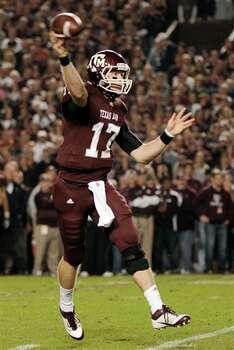 Texas A&M quarterback Ryan Tannehill (17) throws a touchdown pass against Texas during the first quarter of an NCAA college football game, Thursday, Nov. 24, 2011, in College Station, Texas. (AP Photo/Dave Einsel) Photo: Associated Press
