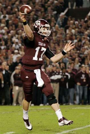 Texas A&M quarterback Ryan Tannehill (17) throws a touchdown pass against Texas during the first quarter of an NCAA college football game, Thursday, Nov. 24, 2011, in College Station, Texas. (AP Photo/Dave Einsel) Photo: Associated Press