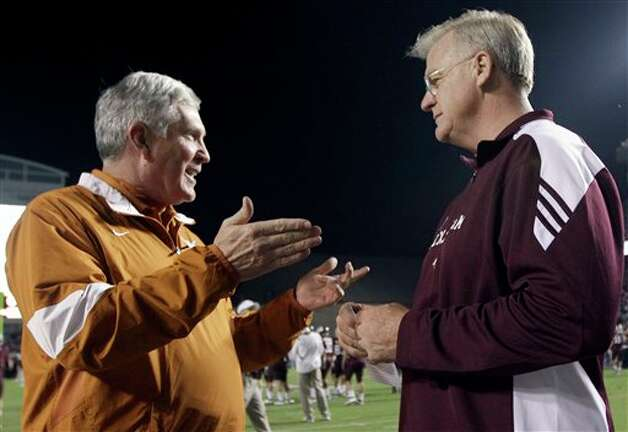 Texas head coach Mack Brown, left, talks with Texas A&M head coach Mike Sherman before an NCAA college football game, Thursday, Nov. 24, 2011, in College Station, Texas. (AP Photo/David J. Phillip) Photo: Associated Press