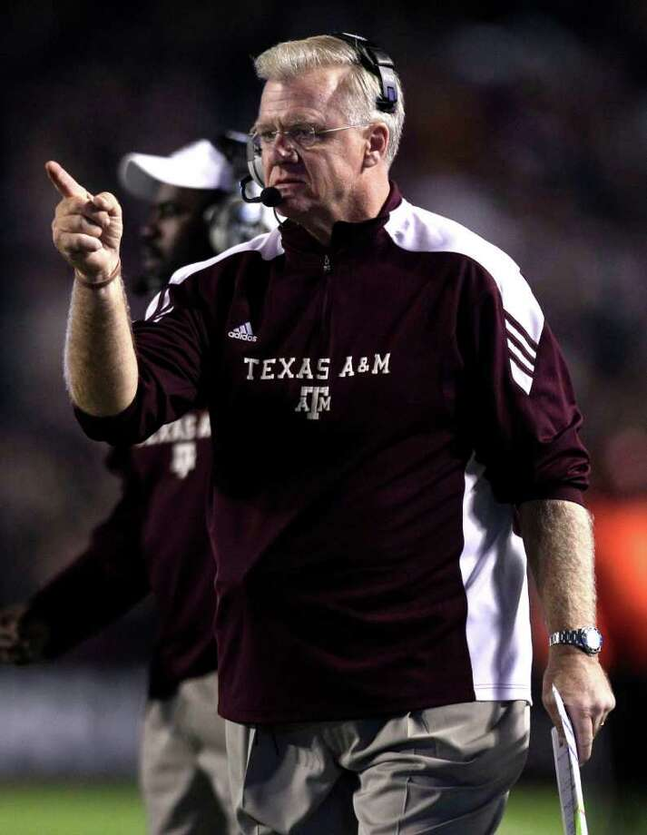 Texas A&M head coach Mike Sherman calls out a play during the first quarter of an NCAA college football game at Kyle Field Thursday, Nov. 24, 2011, in College Station. Photo: Brett Coomer, Houston Chronicle / © 2011 Houston Chronicle