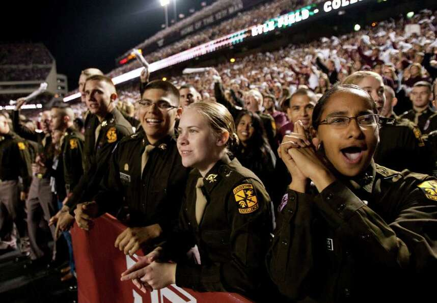 The Texas A&M Corps of Cadets cheer during the first quarter of an NCAA college football game betwee
