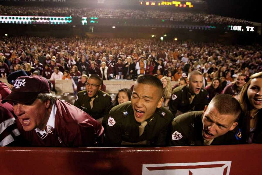 Texas A&M fans cheer during the first quarter of an NCAA college football game between Texas A&M and