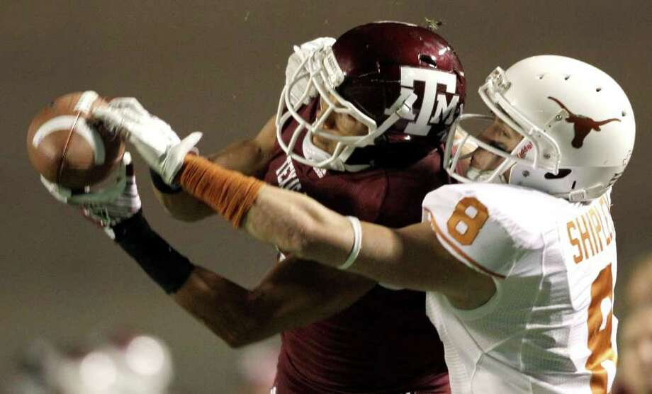 Texas A&M defensive back Trent Hunter, left, breaks up a pass intended for Texas wide receiver Jaxon Shipley (8) during the second quarter of an NCAA college football game, Thursday, Nov. 24, 2011, in College Station, Texas. (AP Photo/David J. Phillip) Photo: David J. Phillip, Associated Press / AP