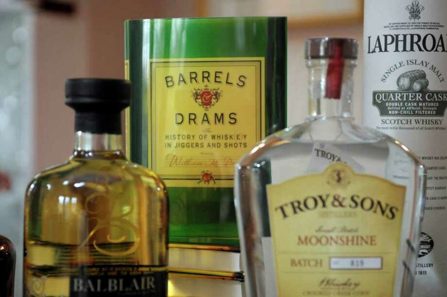"A view of the new book, ""Barrels & Drams: The Histry of Whisk(e)y in Jiggers and Shots"" by author  Bill Dowd, seen here at his home on Thursday, Nov. 17, 2011 in Troy, NY.   (Paul Buckowski / Times Union) Photo: Paul Buckowski / 00015448A"