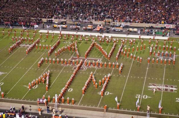 The Texas marching band acknowledges the Texas A&M marching band with a formation honoring the historic rivalry between the universities during halftime of an NCAA college football game, Thursday, Nov. 24, 2011, in College Station, Texas. Photo: AP