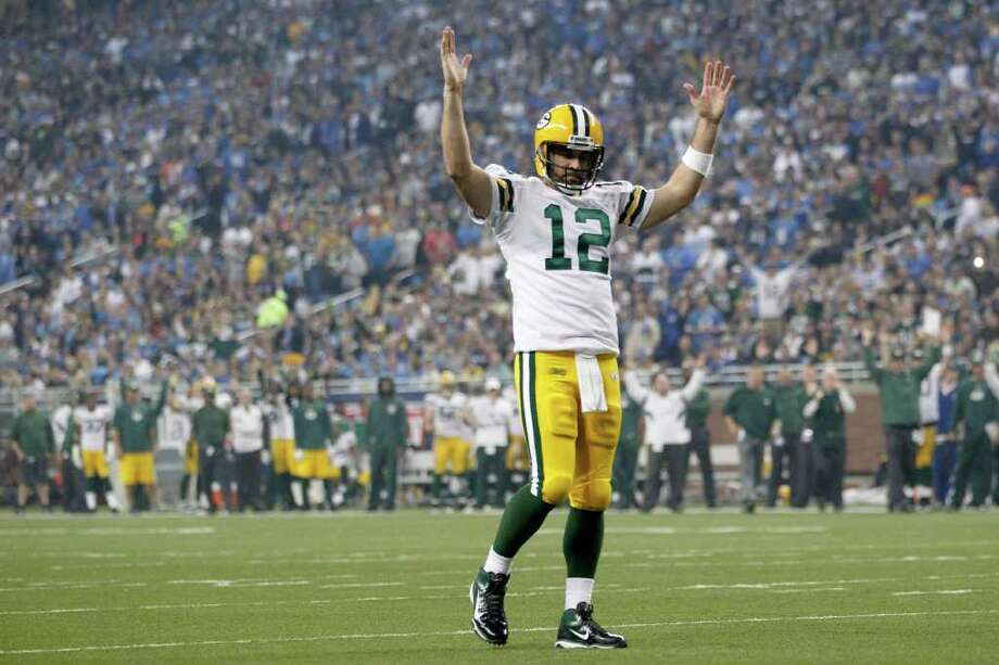 GREGORY SHAMUS: GETTY IMAGES TD SIGNAL: Green Bay quarterback Aaron Rodgers puts an exclamation mark on his 65-yard touchdown pass to James Jones in the third quarter that put the Packers up 21-0. Photo: Gregory Shamus / 2011 Getty Images