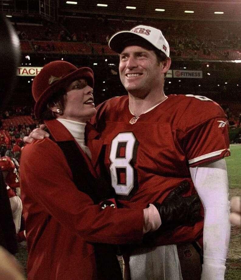 San Francisco 49ers quarterback Steve Young gets a hug from ESPN reporter Lesley Visser after the 49ers beat the New York Giants 31-7, Monday night, Nov. 30, 1998 at San Francisco's 3Com Park. (AP Photo/Paul Sakuma) Photo: PAUL SAKUMA / AP