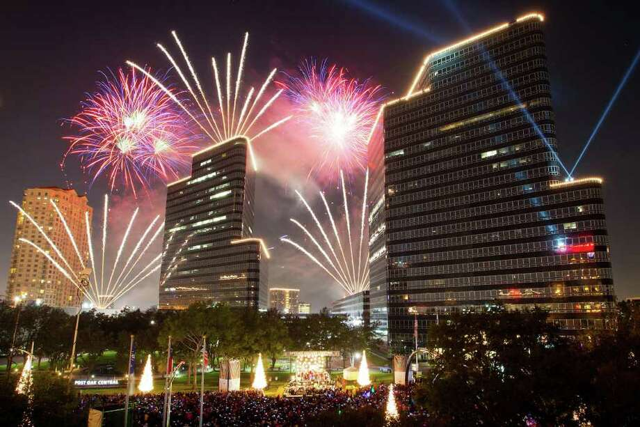 Fireworks explode over the stage during the  26th Annual Uptown Holiday Lighting on Thursday, Nov. 24, 2011, in Houston. Photo: Smiley N. Pool, Houston Chronicle / Copyright: Houston Chronicle