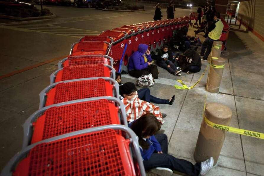 Shoppers hoping for Black Friday deals camp out waiting for the doors at the Target store on San Fel