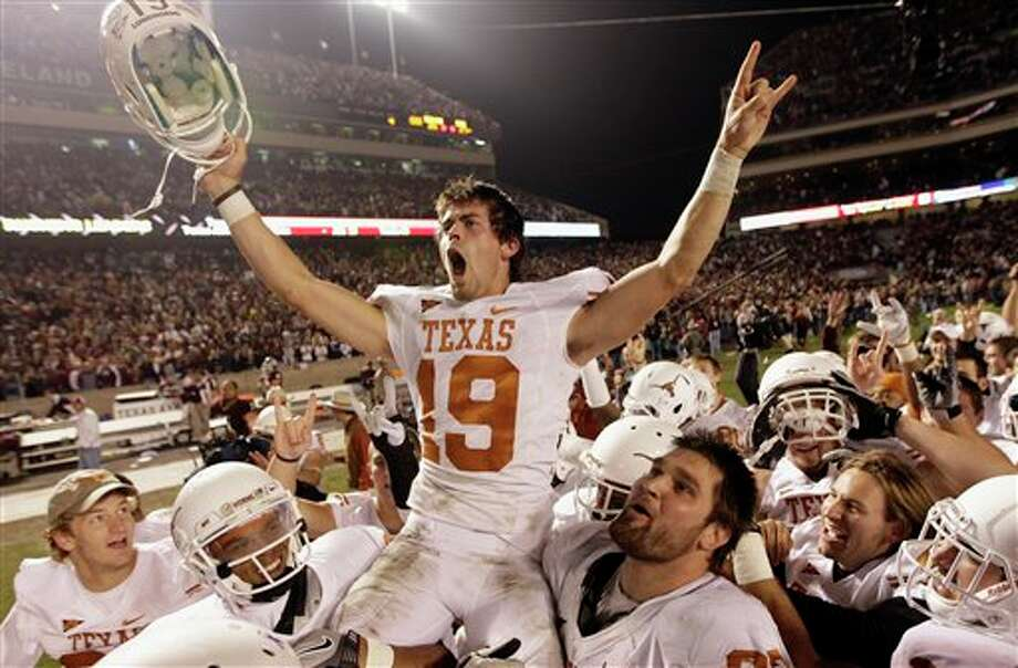Texas kicker Justin Tucker (19) is lifted up by teammates after kicking the game-winning field goal as time expired in an NCAA college football game against Texas A&M, Thursday, Nov. 24, 2011, in College Station, Texas. Texas beat Texas A&M 27-25. (AP Photo/David J. Phillip) Photo: Associated Press