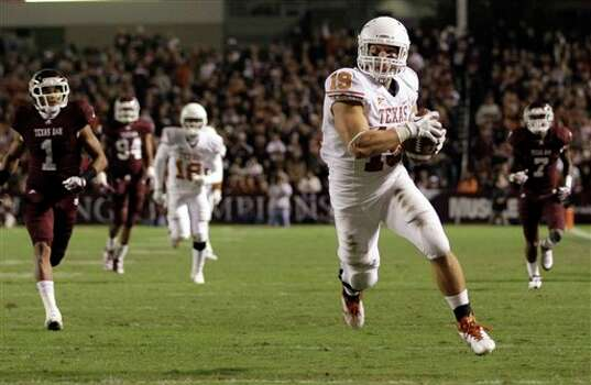 Texas tight end Blaine Irby (19) runs toward the end zone for a 41-yard touchdown catch during the second quarter of an NCAA college football game against Texas A&M, Thursday, Nov. 24, 2011, in College Station, Texas. (AP Photo/David J. Phillip) Photo: Associated Press