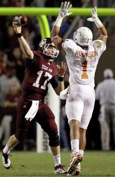 Texas A&M quarterback Ryan Tannehill (17) throws a pass as Texas linebacker Keenan Robinson (1) defends during the first quarter of an NCAA college football game, Thursday, Nov. 24, 2011, in College Station, Texas. (AP Photo/David J. Phillip) Photo: Associated Press